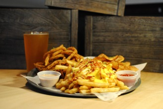 This starter appetizer plate is a great way to start off any meal. Featuring Onion Straws, Potato Chips, and Bacon Cheese Fries, this dish is one you don't want to skip.